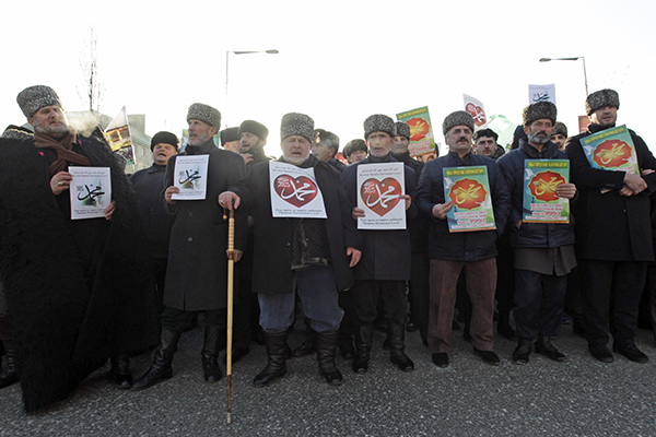 "People attend a rally titled ""Love for the Prophet Mohammad"" to protest against satirical cartoons of the prophet, in Grozny, Chechnya"