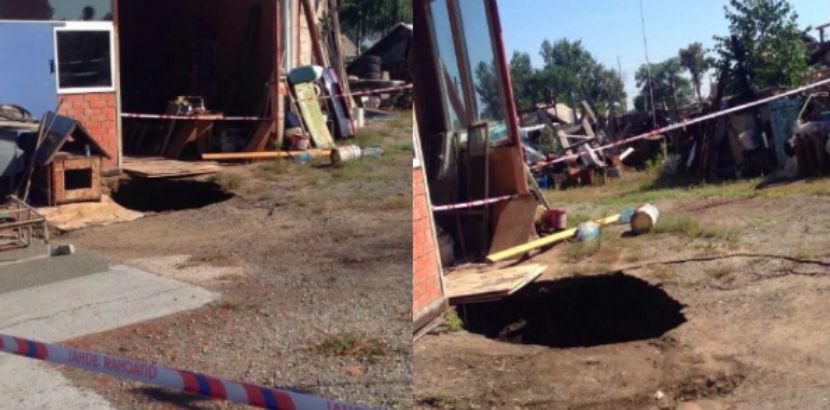 Водителя, провалившегося под землю в собственном дворе, ищут 10 часов