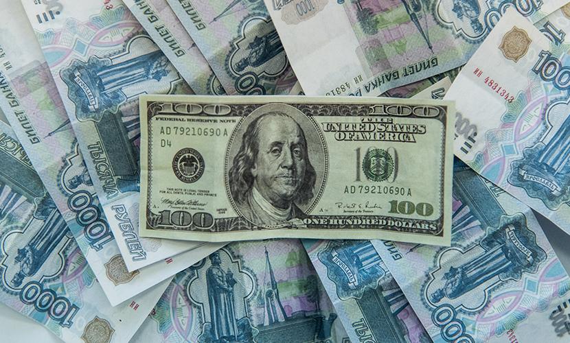 Прогнозом 100 рублей за доллар уже пугает и алюминиевый магнат России