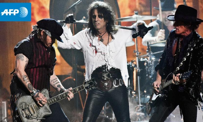 Джонни Депп (слева) выступил в память лидера Motorhead