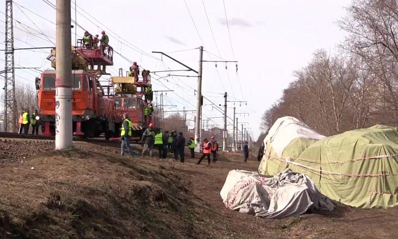 МЧС назвало фамилии госпитализированных после столкновения поезда и электрички в Москве