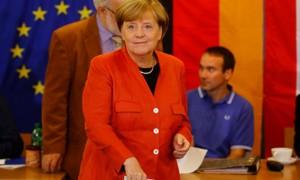 Партия Меркель побеждает на выборах по данным экзит-поллов