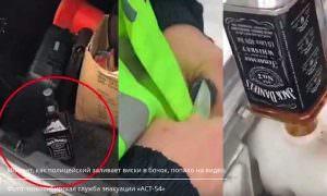«Могу себе позволить!»: новосибирский гаишник заливал в машину виски Jack Daniel's